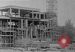 Image of school construction and suburban homes Washington DC USA, 1950, second 15 stock footage video 65675073233