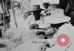 Image of natives gamble Haiti West Indies, 1925, second 20 stock footage video 65675073254