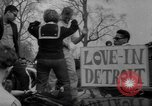 Image of hippies at a Detroit love-in Detroit Michigan USA, 1967, second 42 stock footage video 65675073277