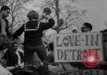 Image of hippies at a Detroit love-in Detroit Michigan USA, 1967, second 43 stock footage video 65675073277