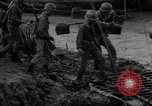 Image of Vietcong captured by Marines Vietnam, 1967, second 28 stock footage video 65675073301