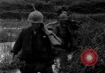 Image of Vietcong captured by Marines Vietnam, 1967, second 40 stock footage video 65675073301
