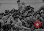 Image of Vietcong captured by Marines Vietnam, 1967, second 59 stock footage video 65675073301
