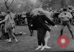 Image of hippies dancing at be-in Seattle Washington USA, 1967, second 32 stock footage video 65675073308