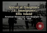 Image of Newly arriving immigrants to America  Ellis Island New York USA, 1906, second 6 stock footage video 65675073417