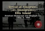 Image of Newly arriving immigrants to America  Ellis Island New York USA, 1906, second 8 stock footage video 65675073417