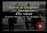 Image of Newly arriving immigrants to America  Ellis Island New York USA, 1906, second 12 stock footage video 65675073417