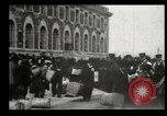 Image of Newly arriving immigrants to America  Ellis Island New York USA, 1906, second 18 stock footage video 65675073417