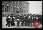 Image of Newly arriving immigrants to America  Ellis Island New York USA, 1906, second 51 stock footage video 65675073417