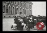 Image of Newly arriving immigrants to America  Ellis Island New York USA, 1906, second 54 stock footage video 65675073417