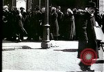 Image of Busy Russian street with pedestrians and streetcar Russia Soviet Union, 1920, second 1 stock footage video 65675073436