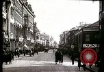 Image of Busy Russian street with pedestrians and streetcar Russia Soviet Union, 1920, second 11 stock footage video 65675073436