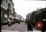 Image of Busy Russian street with pedestrians and streetcar Russia Soviet Union, 1920, second 12 stock footage video 65675073436