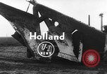 Image of tractor plows Holland Netherlands, 1954, second 2 stock footage video 65675073518