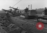 Image of tractor plows Holland Netherlands, 1954, second 7 stock footage video 65675073518