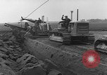 Image of tractor plows Holland Netherlands, 1954, second 9 stock footage video 65675073518