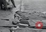Image of emaciated corpses Germany, 1945, second 12 stock footage video 65675073860