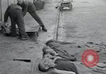 Image of emaciated corpses Germany, 1945, second 13 stock footage video 65675073860