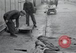 Image of emaciated corpses Germany, 1945, second 16 stock footage video 65675073860