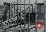 Image of prisoners of camp Hanover Germany, 1945, second 23 stock footage video 65675073890