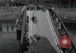 Image of German civilians, soldiers and released Allied prisoners cross bridge Grimma Germany, 1945, second 4 stock footage video 65675073902