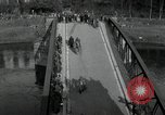 Image of German civilians, soldiers and released Allied prisoners cross bridge Grimma Germany, 1945, second 5 stock footage video 65675073902
