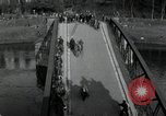 Image of German civilians, soldiers and released Allied prisoners cross bridge Grimma Germany, 1945, second 6 stock footage video 65675073902