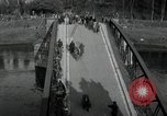 Image of German civilians, soldiers and released Allied prisoners cross bridge Grimma Germany, 1945, second 7 stock footage video 65675073902