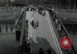 Image of German civilians, soldiers and released Allied prisoners cross bridge Grimma Germany, 1945, second 8 stock footage video 65675073902