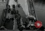 Image of German civilians, soldiers and released Allied prisoners cross bridge Grimma Germany, 1945, second 12 stock footage video 65675073902