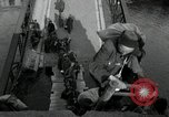 Image of German civilians, soldiers and released Allied prisoners cross bridge Grimma Germany, 1945, second 16 stock footage video 65675073902