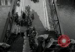Image of German civilians, soldiers and released Allied prisoners cross bridge Grimma Germany, 1945, second 20 stock footage video 65675073902