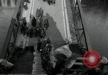 Image of German civilians, soldiers and released Allied prisoners cross bridge Grimma Germany, 1945, second 21 stock footage video 65675073902