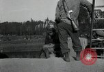 Image of German civilians, soldiers and released Allied prisoners cross bridge Grimma Germany, 1945, second 22 stock footage video 65675073902