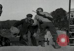 Image of German civilians, soldiers and released Allied prisoners cross bridge Grimma Germany, 1945, second 24 stock footage video 65675073902