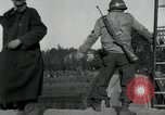 Image of German civilians, soldiers and released Allied prisoners cross bridge Grimma Germany, 1945, second 25 stock footage video 65675073902
