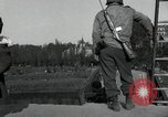 Image of German civilians, soldiers and released Allied prisoners cross bridge Grimma Germany, 1945, second 29 stock footage video 65675073902