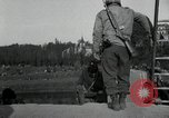 Image of German civilians, soldiers and released Allied prisoners cross bridge Grimma Germany, 1945, second 31 stock footage video 65675073902