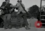Image of German civilians, soldiers and released Allied prisoners cross bridge Grimma Germany, 1945, second 34 stock footage video 65675073902