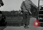 Image of German civilians, soldiers and released Allied prisoners cross bridge Grimma Germany, 1945, second 35 stock footage video 65675073902