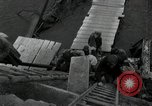 Image of German civilians, soldiers and released Allied prisoners cross bridge Grimma Germany, 1945, second 45 stock footage video 65675073902