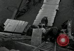 Image of German civilians, soldiers and released Allied prisoners cross bridge Grimma Germany, 1945, second 46 stock footage video 65675073902