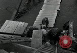 Image of German civilians, soldiers and released Allied prisoners cross bridge Grimma Germany, 1945, second 47 stock footage video 65675073902