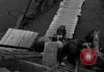 Image of German civilians, soldiers and released Allied prisoners cross bridge Grimma Germany, 1945, second 48 stock footage video 65675073902