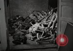 Image of pile of emaciated corpses Germany, 1945, second 13 stock footage video 65675073907