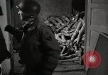 Image of pile of emaciated corpses Germany, 1945, second 20 stock footage video 65675073907