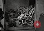 Image of pile of emaciated corpses Germany, 1945, second 25 stock footage video 65675073907