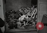 Image of pile of emaciated corpses Germany, 1945, second 28 stock footage video 65675073907