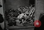 Image of pile of emaciated corpses Germany, 1945, second 58 stock footage video 65675073907