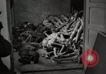 Image of pile of emaciated corpses Germany, 1945, second 59 stock footage video 65675073907